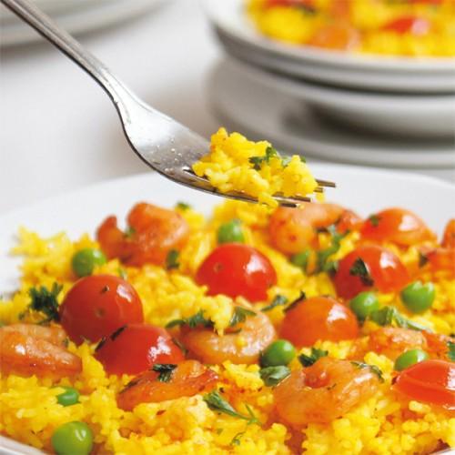 Riso al curry con gamberi e pomodorini