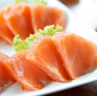 Sashimi di salmone norvegese con arancia e scarola riccia